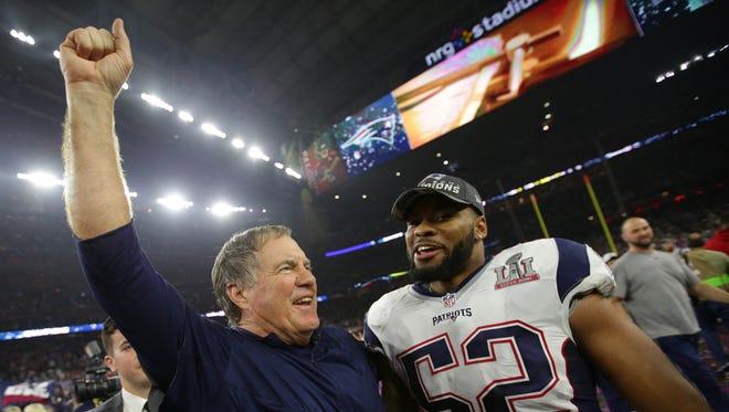 New England Patriots head coach Bill Belichick celebrates with outside linebacker Elandon Roberts (52) after defeating the Atlanta Falcons during Super Bowl LI at NRG Stadium.