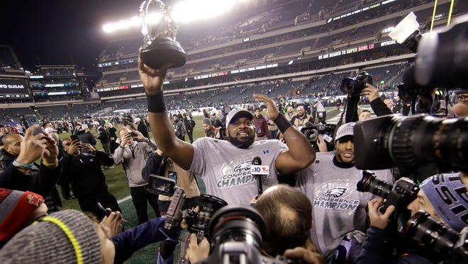 Fletcher Cox (center) has gone on to become a Super Bowl champion and three-time All-Pro and sign a $100 million contract.