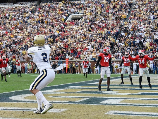 Georgia Tech Yellow Jackets wide receiver Ricky Jeune catches a touchdown pass against the Georgia Bulldogs during the first half at Bobby Dodd Stadium.