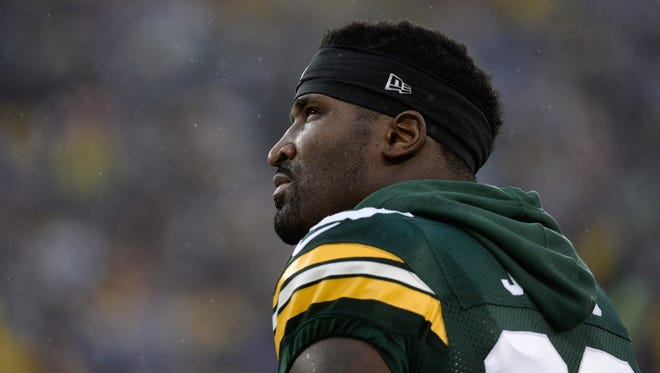 Green Bay Packers wide receiver James Jones (89) looks up to the stands before the start of the game against the Cowboys.