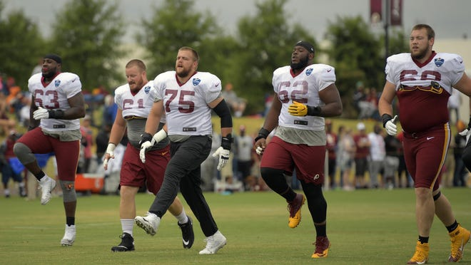 Washington offensive linemen warm up as they ready for practice. From left to right: Isaiah Williams (63), Spencer Long (61), Brandon Scherff (75), Ronald Patrick (62) and John Kling (68) during an afternoon practice at the the Redskins' training camp in Richmond, Va. Must credit: Washington Post photo by John McDonnell