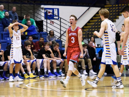 Lincoln's Carson Coulter (3) celebrates their 52-45 win over O'Gorman in a state boys class AA basketball quarterfinal Thursday at the Sioux Falls Arena, March 17, 2016.