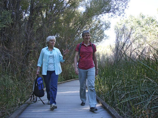 Secretary of the Interior Sally Jewell, right, tours the Morongo Canyon Preserve with former preserve manager Robin Kobaly Tuesday. Jewel was in the Palm Springs area on Tuesday to mark the release of the Desert Renewable Energy Conservation Plan (DRECP).