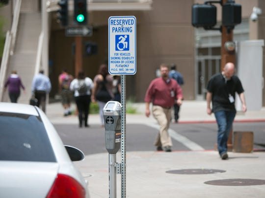 Phoenix's new accessibility street signs are seen at