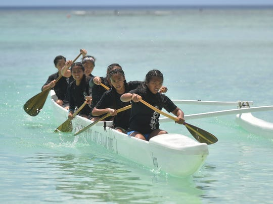 The Simon Sanchez High School Sharks Manhoben Famalaoan division team competes during their Independent Interscholastic Association of Guam and the Guam Kayak and Canoe Federation Paddling Series 500-meter race at Matapang Beach in Tumon on May 20, 2017.