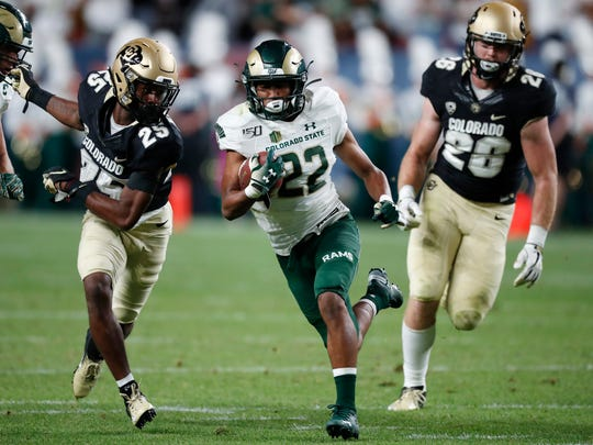 Colorado State wide receiver Dante Wright, center, runs for a touchdown past Colorado cornerback Mekhi Blackmon, left, and linebacker Carson Wells during the second quarter of an NCAA college football game Friday, Aug. 30, 2019, in Denver. (AP Photo/David Zalubowski)