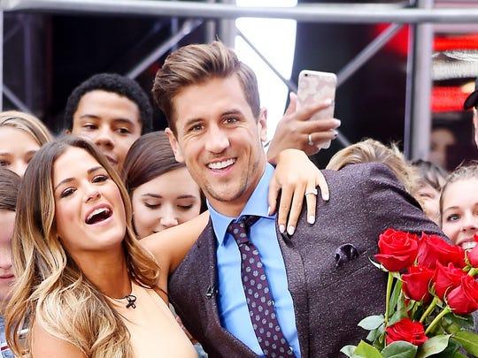 Bachelorette JoJo Fletcher and Jordan Rodgers share a kiss on the set of Good Morning America in 2016.