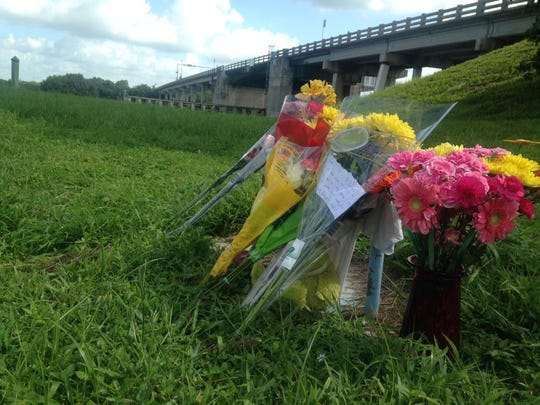 A memorial for Chelsey Green sits near the State Road