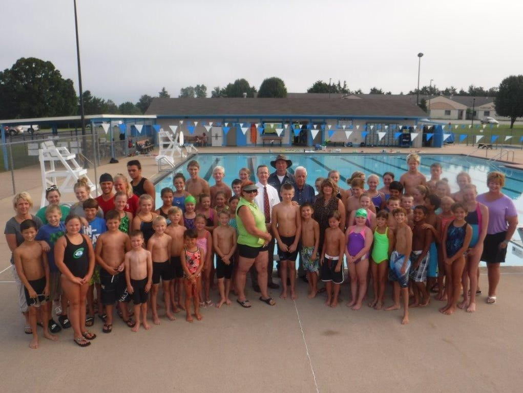 The Mountain Home Hurricane swim team was able to recently purchase eight brand new swim blocks for the city pool. Shown are Hurricane swimmers, coaches and board members with Mountain Home Mayor Joe Dillard at the city pool.