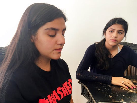 Bianca Retana, 15, left, and her sister, Miranda, 16, right, talk on Wednesday, March 21, 2018, in Albuquerque, N.M., about their teen soccer game where racial tensions erupted into a chaotic brawl on Saturday, March 17, in Bernalillo, N.M. A New Mexico youth soccer league is investigating the soccer game where parents say a parent from an opposing team ran onto the field and choked Bianca Retana from behind.