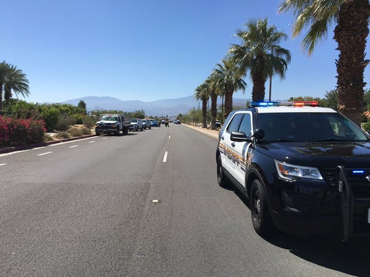 Police close down Bob Hope Drive in Rancho Mirage after a bicyclist was killed in a collision.