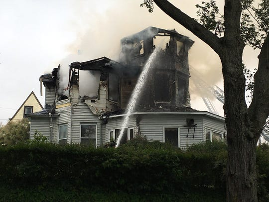 Mount Vernon firefighters battle a house fire on East