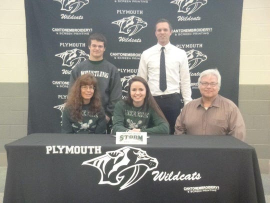 Plymouth senior Michelle Burke (seated, center) is