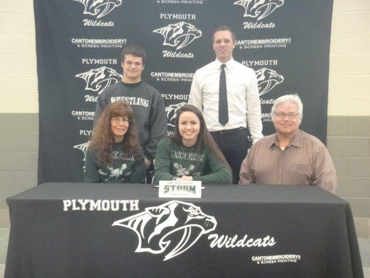 Plymouth senior Michelle Burke (seated, center) is flanked by parents Charlotte and Rick Burke on National Signing Day. Standing are her brother, Ricky, and Plymouth athletic director Kyle Meteyer.