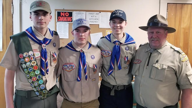 Marlboro Boy Scout Troop 72, under the leadership of Scoutmaster Kurt Borchert, right, recently hosted a Court of Honor to acknowledge Scouts, from left, Avery Albright, Eric Borchert and Max Borchert for having reached the rank of Eagle Scout. With the advancement of these three Scouts, Troop 72 has celebrated nine Eagle Scouts in the past two years.