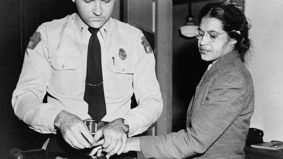 Rosa Parks is fingerprinted after being arrested on Dec. 1, 1955, for refusing to give up her bus seat to a white man.
