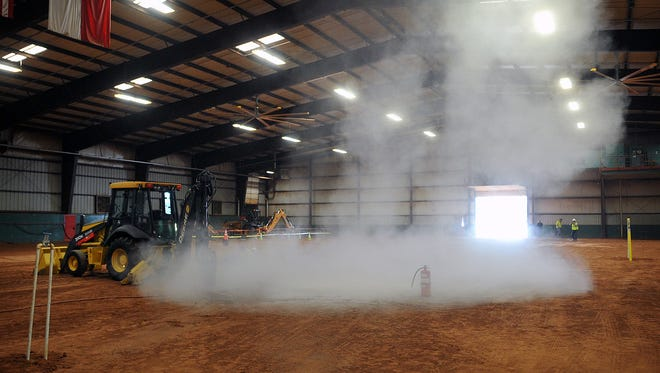 Talcum powder was used to simulate natural gas released after a mock gas line strike Thursday at the Bridwell Ag Center. The scene was used to encourage everyone to call Texas 811 before digging.