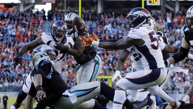 League MVP Cam Newton was sacked five times and lost two fumbles. Von Miller of the Broncos, who forced this first-half fumble which resulted in a touchdown, had 2.5 sacks.