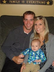 Kyle and Jenna Heckendorf hold their son, Bryce. Bryce