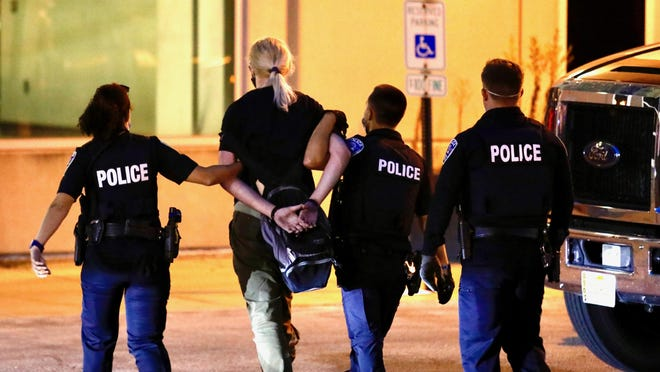 Police arrest a protester on Friday, Aug. 21, 2020, after demonstrations outside Rockford City Market.