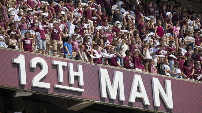 Texas A&M fans wave 12th Man towels in the student section of Kyle Field during a 2017 game. The SEC on Tuesday released its guidelines for fans to potentially attend football games during the COVID-19 pandemic this season.