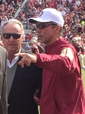 Monk Bonasorte with former FSU coach Bobby Bowden during Saturday's FSU-North Carolina State football game at Doak Campbell Stadium.