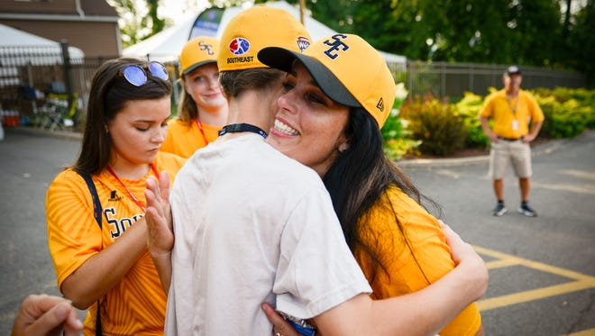 Goodlettsville first baseman Tyler Jones hugs family friend Susan Flowers of Goodlettsville after their 4-2 loss to Maine-Endwell in the U.S. championship baseball game at the Little League World Series in South Williamsport, Pa., Saturday, Aug. 27, 2016.