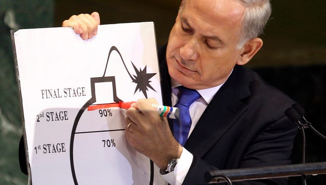 Israeli Prime Minister Benjamin Netanyahu draws on a diagram of a bomb as he describes his concerns over Iran's nuclear ambitions during his address at the 67th session of the United Nations General Assembly on Sept. 27, 2012, in New York.