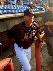 B- Mets manager Pedro Lopez steps out of the dugout at NYSEG Stadium during his Binghamton Baseball Shrine induction ceremony last year.