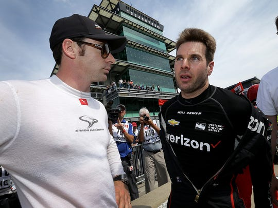 Team Penske IndyCar driver Will Power (12),right, talks with teammate  Simon Pagenaud (1) following his qualifying run for the Indianapolis 500 Friday, May 20, 2017, afternoon at the Indianapolis Motor Speedway.