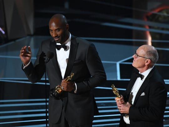 Basketball legend Kobe Bryant (left, with Glen Keane)