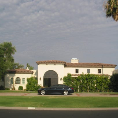 Amar and Maya Thosani paid $2.51 million for this 7,177 square-foot home at Camelback Country Estates in Paradise Valley. The sale closed during the week of June 22, 2015.