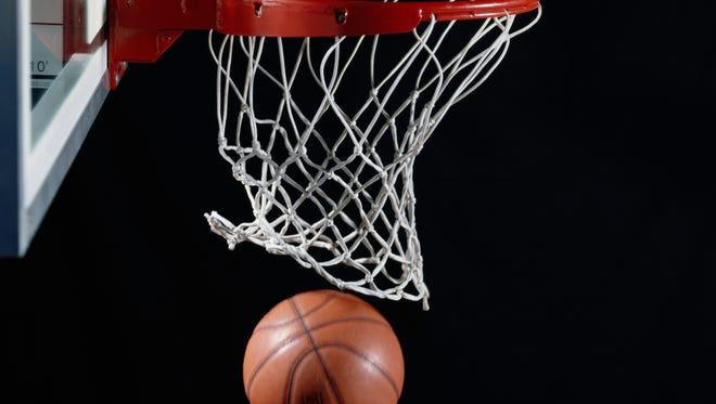 Basketball in hoop file photo