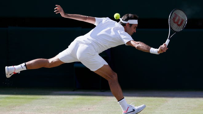 Switzerland's Roger Federer returns to Czech Republic's Tomas Berdych during their Men's Singles semifinal match on day 11 at the Wimbledon Tennis Championships in London, Friday, July 14, 2017.