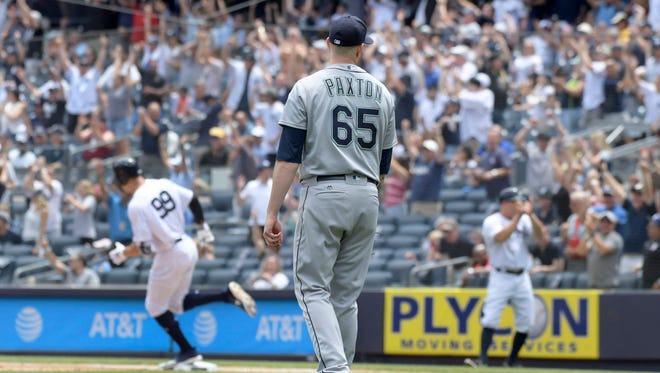 Mariners starter James Paxton watches Aaron Judge of the Yankees circle the bases after hitting a first-inning home run on Thursday in New York.