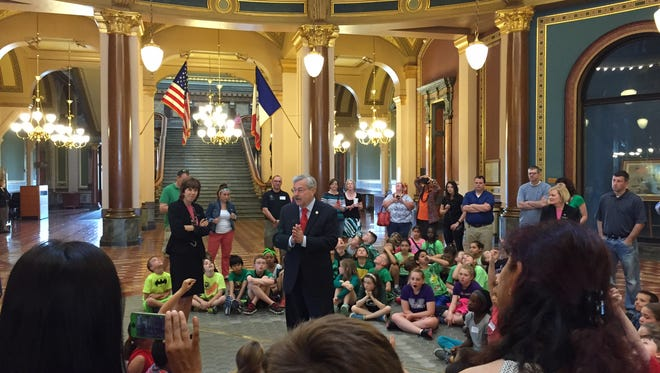 """Gov. Terry Branstad talks to schoolchildren from Waukee on Wednesday in the Iowa Capitol Rotunda. In a response to a question from one inquisitive student, Branstad was heard to say, """"I was very happy to become governor."""" As lawmakers push toward adjournment of their 2015 session, Branstad is urging lawmakers to adopt a two-year K-12 education spending plan, and to approve bills to expand high-speed Internet service in underserved areas and prevent bullying in schools."""