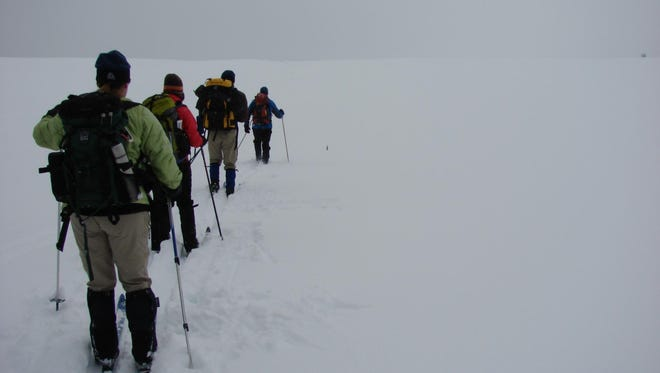 Yellowstone Expedition guests ski in a whiteout to the Forest Mud Pots.