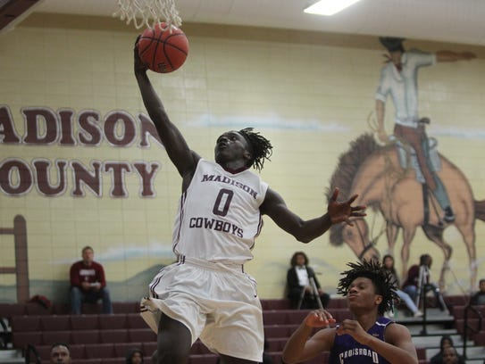Madison County's Travis Jay skies for a layup during