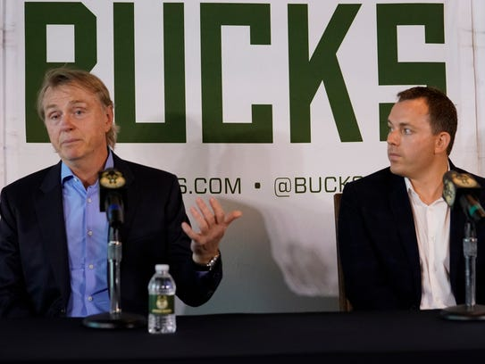 Milwaukee Bucks co-owner Wes Edens (left) introduces