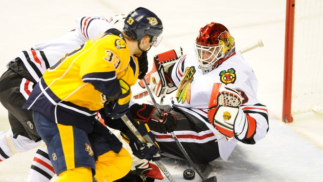 Chicago Blackhawks goalie Scott Darling (33) makes a save on Nashville's Colin Wilson during the third period Wednesday.