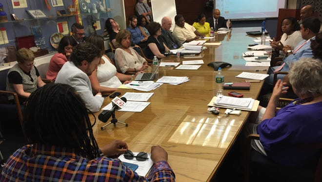 City Council members discuss Mayor Lovely Warren's proposal for a feasibility study on a downtown performing arts center on July 13, 2015.