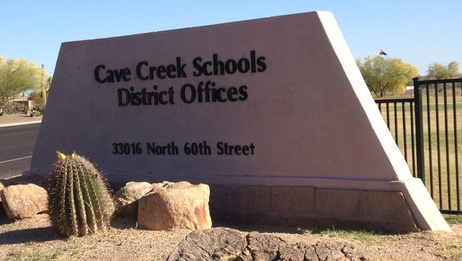 The Cave Creek Unified School District offices are actually in Scottsdale. A school-board candidate believes changing the district's name would help pass overrides and bonds.