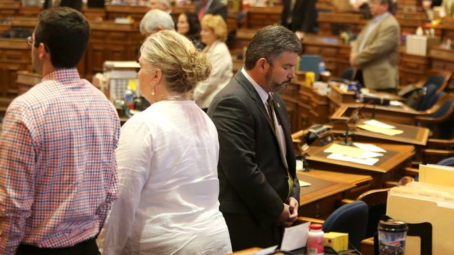 Rep. Rob Taylor, R-West Des Moines, turns his back to Wiccan priestess Deborah Maynard of Cedar Rapids as she delivers the morning invocation on Thursday, April 9, 2015, at the Capitol.