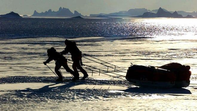 Ann Bancroft of Scania, Minn., left, and her partner Liv Arnesen of Norway, test their 250-pound (113 kilogram) sled  in Blue One, Antarctica Monday Nov. 13, 2000.