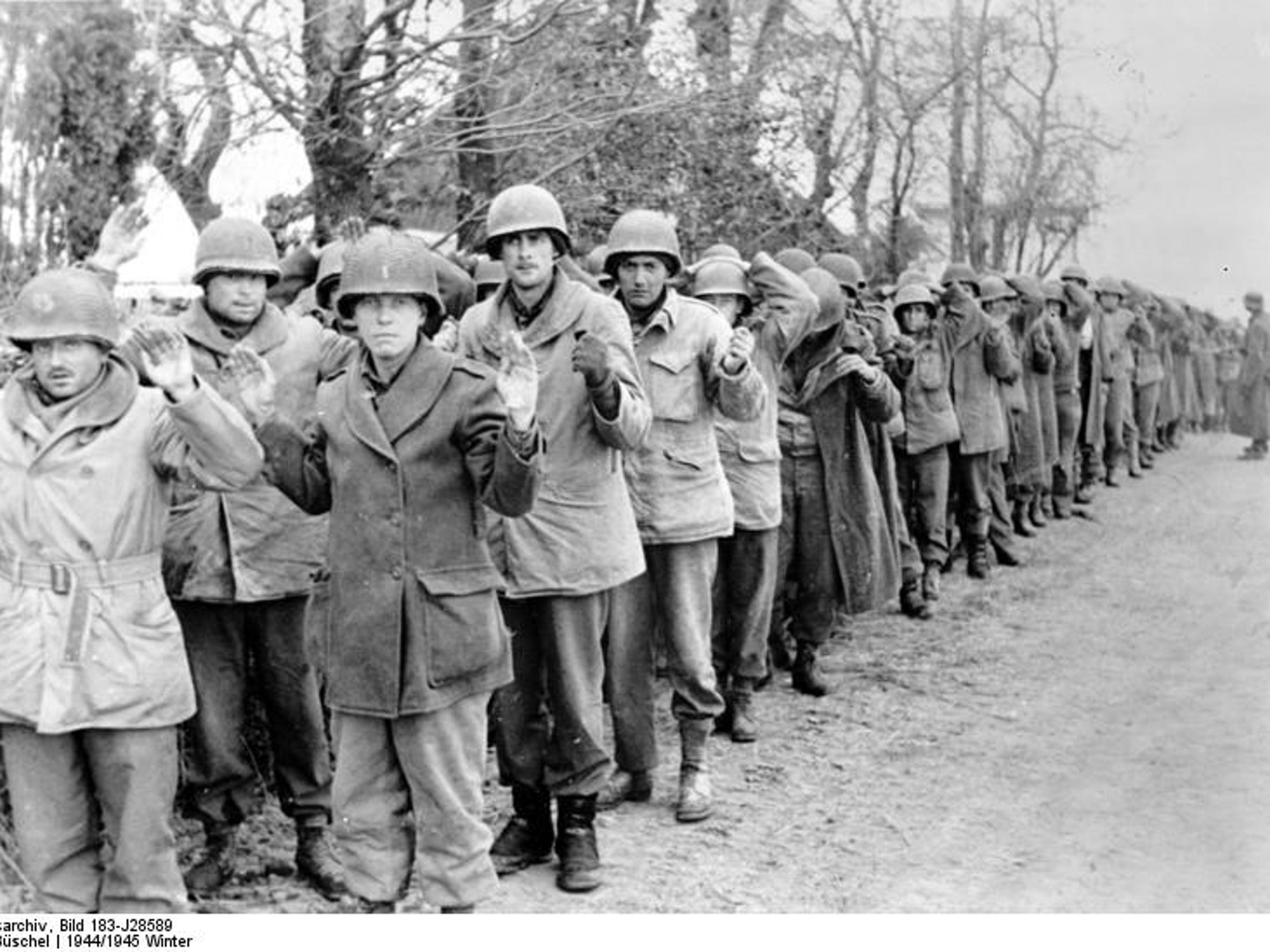 US POWs on 22 December 1944, captured during the Battle of the Bulge.  Keith Ginther of Choteau was among the POWs captured but is not necessarily in this picture.
