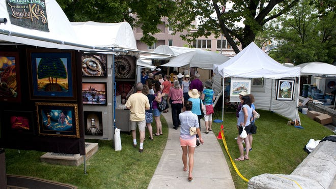 Patrons, shown here in 2012, will be able to see work from artists based in several states at Saturday's Round the Fountain Art Fair.