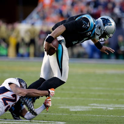 Carolina Panthers? Cam Newton (1) is tackled by Denver