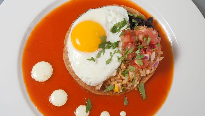 The North End Cafe's popular huevos rancheros starts with a fried corn tortilla topped with a fried egg, Spanish rice,  black beans and  pico de gallo sauce and is topped with cilantro. The tortilla sits atop the restaurant's house-made rancheros sauce and is finished with a dotting of sour cream. May 21, 2018