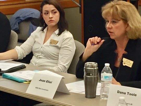 Joan Eliel, right, speaks in March to the Sexual Assault Kit Initiative Task Force. Looking on is Erin Davis.
