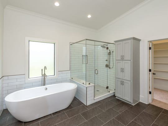 The bathroom features sleek, stylish updates.